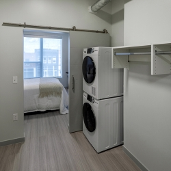 View of one bedroom in-unit washer and dryer