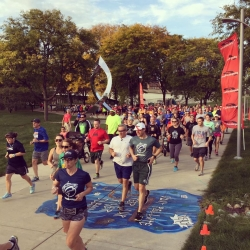 A crowd of runners at a local 5K event in downtown Lansing.