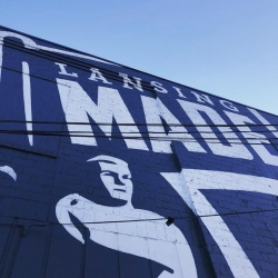 "A mural on the outside of the Lansing Brewing Company building says ""Lansing Made."""